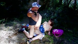 Glasses wearing brunette gets pounded somewhere in the forest