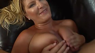 Slutty milf giving outstanding boobjob with her beautiful tits