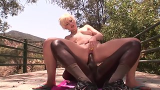 Short haired blonde milf gets rammed outside by a bbc