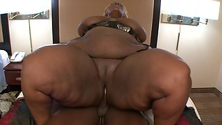 Fat ebony gets her pussy nailed by a huge black cock