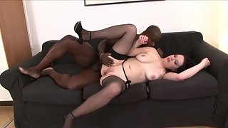Pale skinned dark haired babe gets a hard bbc in her twat