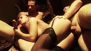 Astonishing brunette in lingerie and stockings enjoys threeway