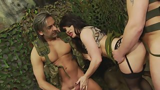 Hot girl gets screwed in threesome at military camp