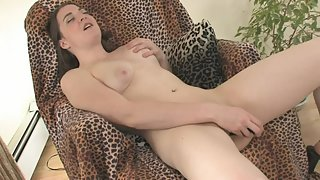 Slutty brunette rubs her pussy and uses dildo to masturbate