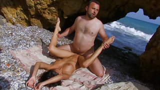 Black haired whore gets pounded by big cock on the beach