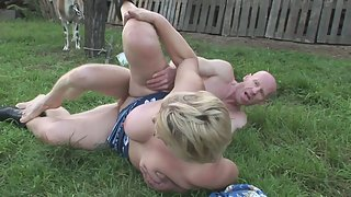 Chubby blonde granny fucks her pussy outdoors