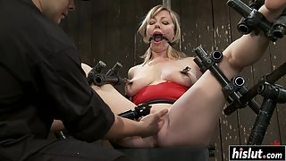 Blonde girl got her cunt punished in metal bondage device