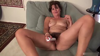 Mature Lady Dildoing Herself Over Couch for Pleasure
