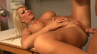 Horny doctor slams busty blonde MILF in the doctor's office