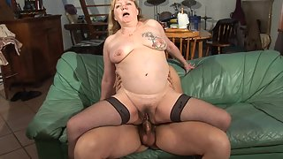 Busty granny in stockings takes huge cock in the ass