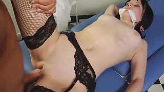 Pale-skinned dark-haired babe is gagged and fucked hard