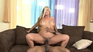 Curvy blonde enjoys riding big black cock