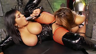 Busty lesbian couple enjoying their time in the dungeon