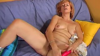 Dirty mature masturbates with a red vibrator