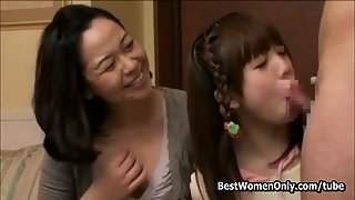 Japanese mum and daughter suck the same dick