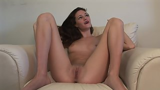 Petite black haired chick shows small tits and masturbates