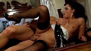 Dark haired babe gets hammered hard in the pussy