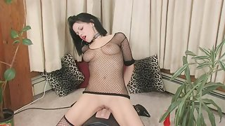 Black haired chick in fishnets rides huge dildo machine
