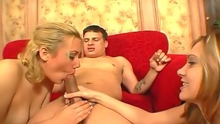 Two Stunning Sluts Hungrily Sucking and Sharing Partner Cock