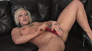 Sexy blonde makes her pussy wet with her favorite dildo