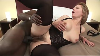Blonde milf in black stockings takes a monster black cock