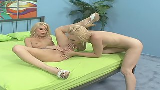 Young blonde lesbians toying and having oral sex