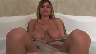Busty blonde cunt is in bathtub and she is horny