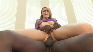 Stockings wearing lady takes big black cock in the ass