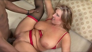 Blonde busty lady screams a lot during interracial sex