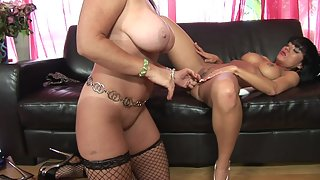 Busty lesbians on leather couch enjoying wild sex